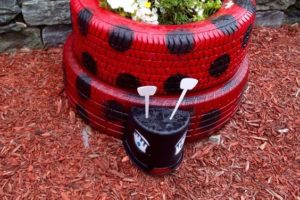 Growing flowers in a ladybird tyre planter!