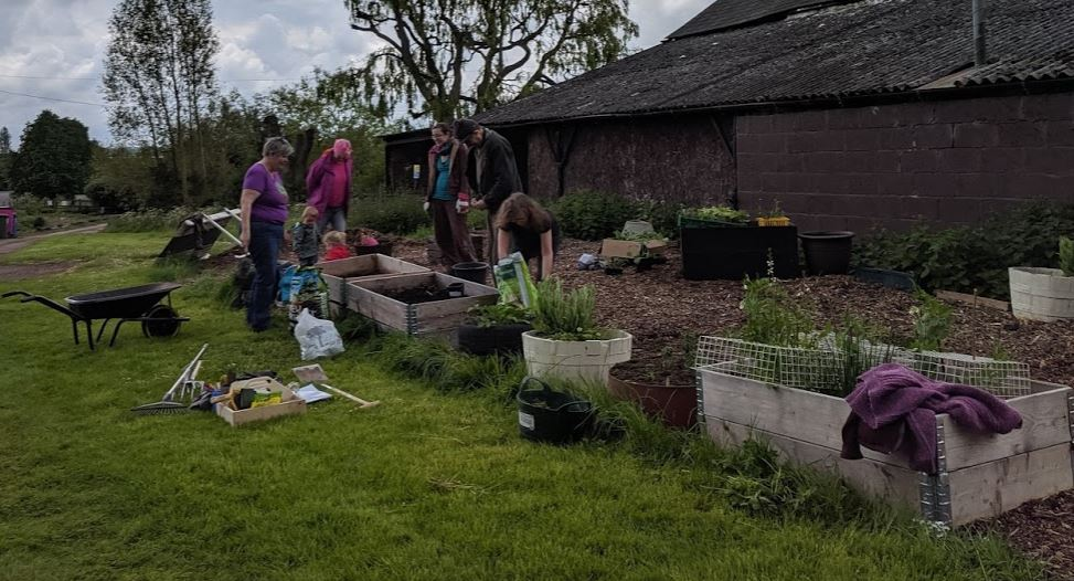 Mucking in with a permablitz in on our permaculture community garden