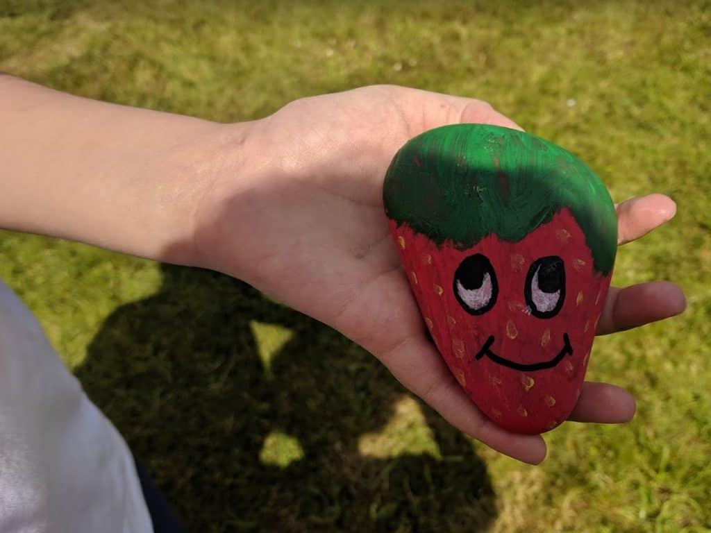 A strawberry pebble sign