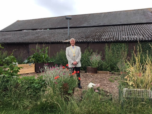 Milton Keynes Mayor, Cllr Sam Crooks in the Planting Up community garden