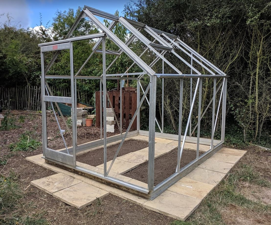 The greenhouse has a new concrete base